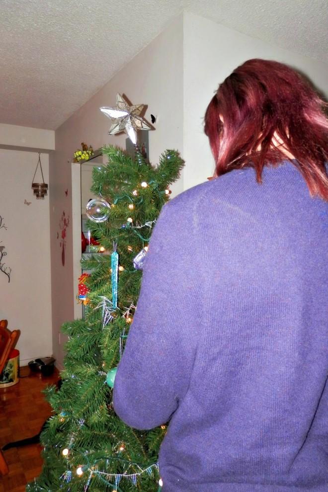 Jeremy decorating the tree.
