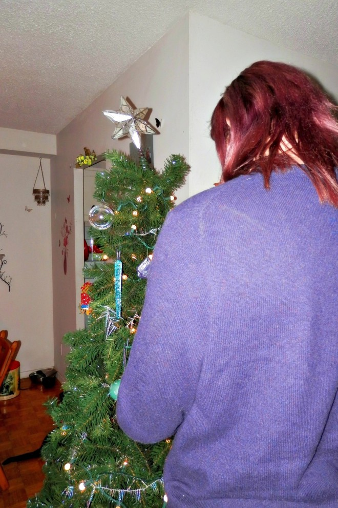 Jeremy decorating the tree.