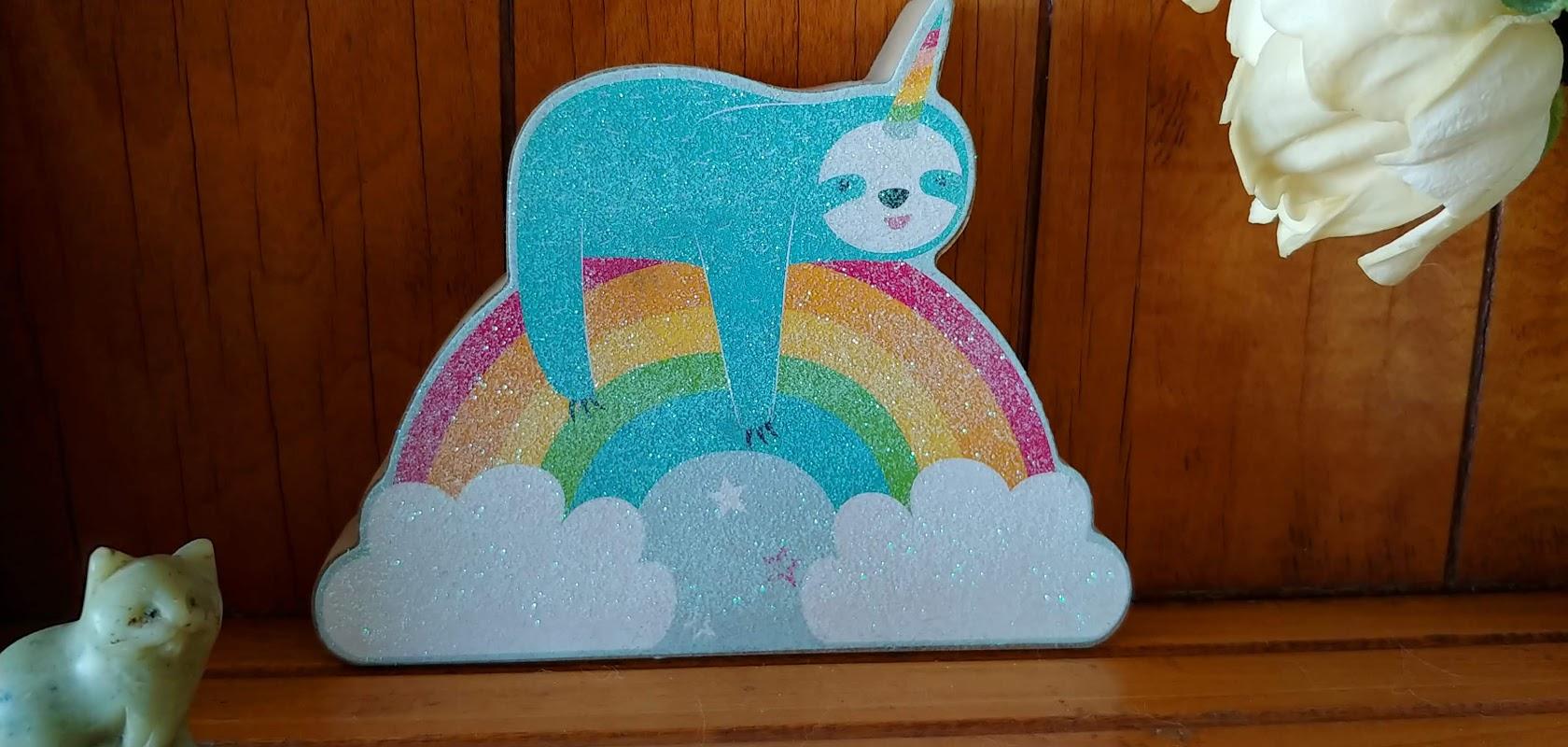 unicorn sloth on a rainbow