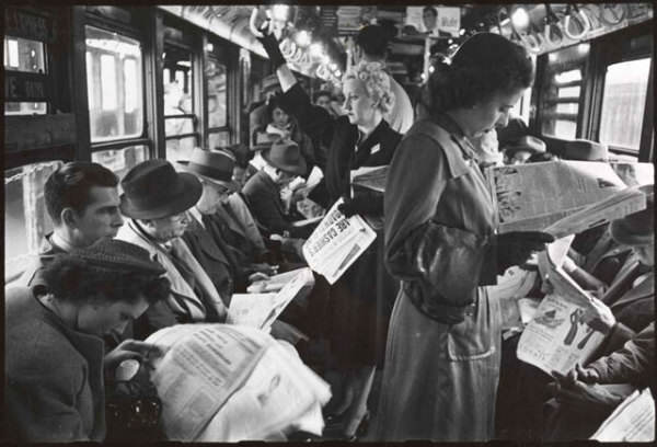 reading newspapers on the bus